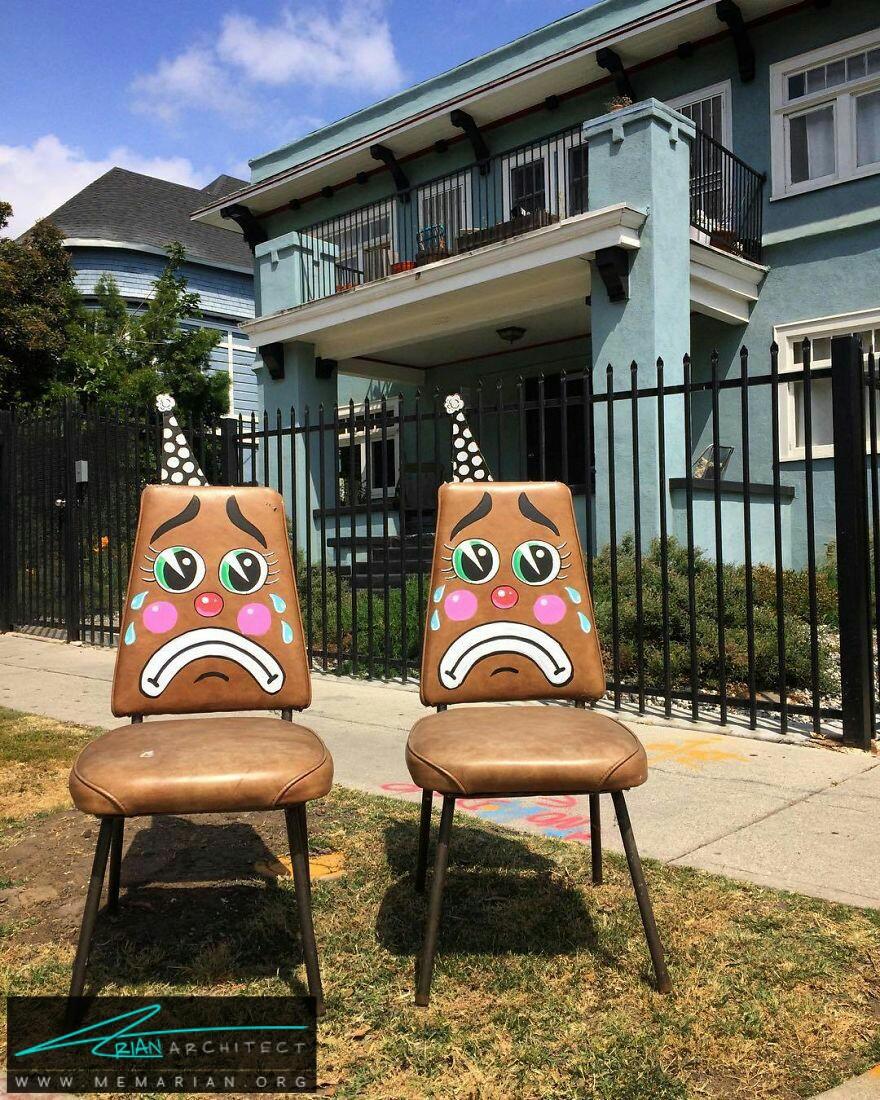 چهره دلقک های غمگین در سطح شهر - آثار هنری خیابانی