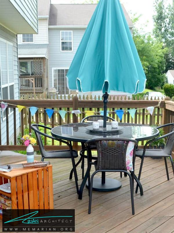 میز ساده و دلنشین به همراه چتر محافظ-دکوراسیون پاسیو