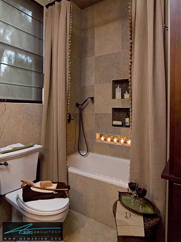 حمام کوچک با سنگ های اطراف وان زمینی -تزیین دکوراسیون حمام