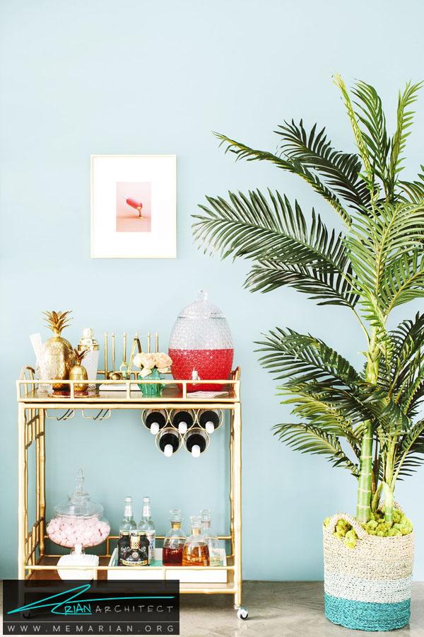 گلدان سرسبز در گوشه خانه -چیدمان اتاق پذیرایی